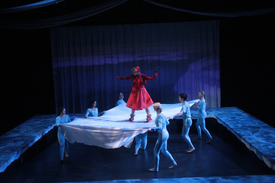 Video Design for the Rose and the Rime, a woman suspended on an ice bridge as a river rushes behind her